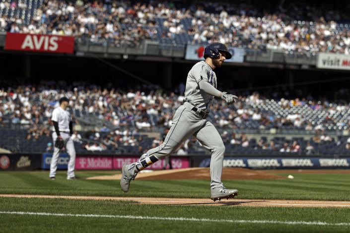 Tampa Bay Rays' Brandon Lowe rounds first base after hitting a 3-run home run during the first inning of a baseball game off of New York Yankees pitcher Jordan Montgomery on Saturday, Oct. 2, 2021, in New York. (AP Photo/Adam Hunger)