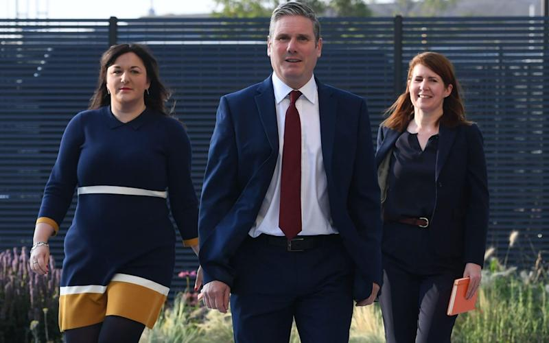 Labour leader Sir Keir Starmer arrives at the speech with Ruth Smeeth (L) and his political director Jenny Chapman (R) - Shutterstock