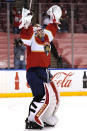 Florida Panthers goaltender Chris Driedger celebrates after an NHL hockey game against the Dallas Stars, Monday, Feb. 22, 2021, in Sunrise, Fla. The Panthers won 3-1. (AP Photo/Lynne Sladky)