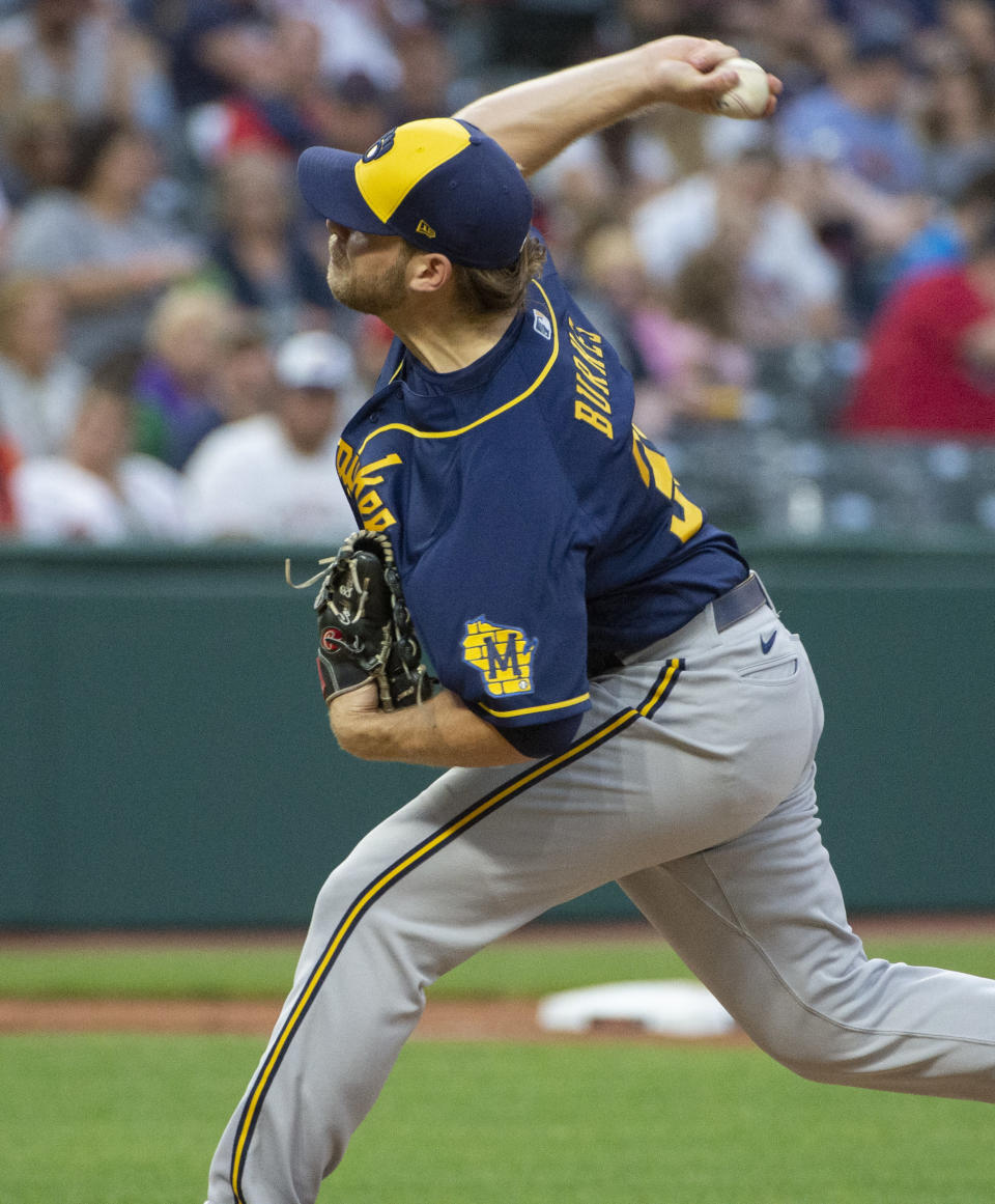 Milwaukee Brewers starting pitcher Corbin Burnes throws to strike out Cleveland Indians' Franmil Reyes during the fifth inning of a baseball game in Cleveland, Saturday, Sept. 11, 2021. (AP Photo/Phil Long)