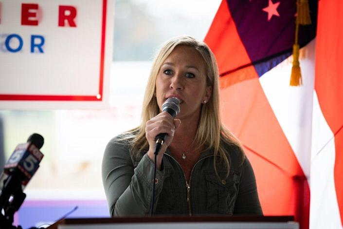 Georgia Republican House candidate Marjorie Taylor Greene endorses Sen. Kelly Loeffler (R-GA) during a press conference on October 15, 2020 in Dallas, Georgia. (Photo by Dustin Chambers/Getty Images)