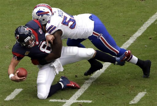 Houston Texans quarterback Matt Schaub (8) is sacked by Buffalo Bills defensive end Kyle Moore in the first quarter of an NFL football game on Sunday, Nov. 4, 2012, in Houston. (AP Photo/David J. Phillip)