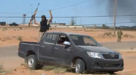 A still image from video released May 17, 2016 shows forces loyal to Libyan unity government celebrating the recapture of Abu Grain, one of the main checkpoints south of the city of Misrata, Libya from Islamic State. MISRATA TV via REUTERS.