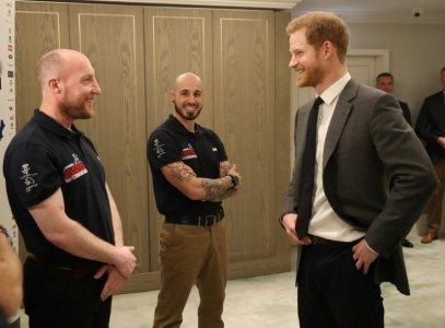 Britain's Prince Harry meets wounded veterans from the U.S and UK whom will walk 1,000 miles from the west to the east coast of America in 14 weeks at a launch in London, April 11, 2018. Chris Jackson/Pool via Reuters
