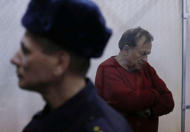 PHOTO: Russian historian and professor Oleg Sokolov, who is accused of murdering his girl friend and former student, stands inside a defendants' cage before a court hearing in Saint Petersburg, Russia, Nov. 11, 2019. (Anton Vaganov/Reuters)