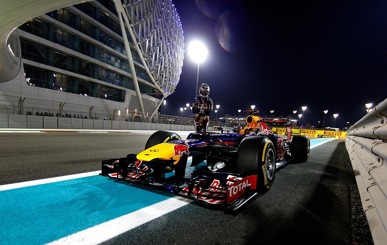ABU DHABI, UNITED ARAB EMIRATES - NOVEMBER 03:  Sebastian Vettel of Germany and Red Bull Racing stands next to his car on the track after qualifying for the Abu Dhabi Formula One Grand Prix at the Yas Marina Circuit on November 3, 2012 in Abu Dhabi, United Arab Emirates.  (Photo by Vladimir Rys/Getty Images)