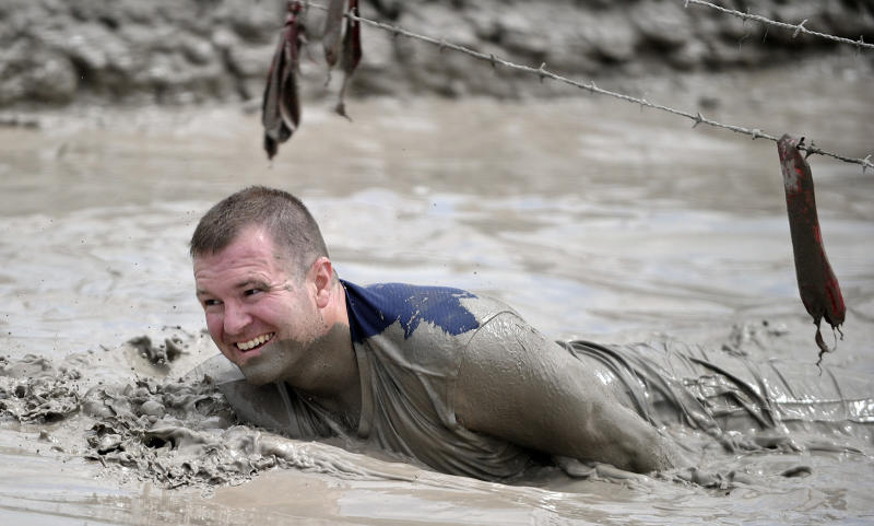 In this June 17, 2012 photo, Jeffrey Boehmer makes his way through the Muddy Mayhem obstacle at the Warrior Dash at Pocono Raceway in Long Pond, Pa. Virtually overnight, obstacle courses have become a favorite diversion of thrill-seekers and weekend warriors. (AP Photo/Scranton Times & Tribune, Melissa Evanko) WILKES BARRE TIMES-LEADER OUT; MANDATORY CREDIT