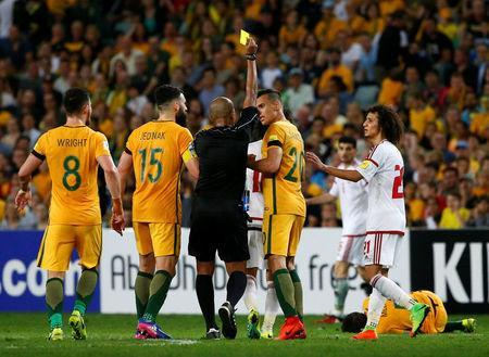 Football Soccer - Australia vs United Arab Emirates - 2018 World Cup Qualifying Asian Zone - Group B - Sydney Football Stadium, Sydney, Australia - 28/3/17 - UAE's Omar Abdulrahman receives a yellow card for his tackle. REUTERS/David Gray