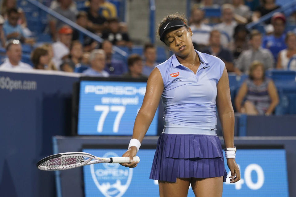 Naomi Osaka, of Japan, reacts after missing a shot against Jil Teichmann, of Switzerland, during the Western & Southern Open tennis tournament Thursday, Aug. 19, 2021, in Mason, Ohio. (AP Photo/Darron Cummings)