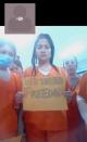 Migrants detained in an ICE detention facility in rural Louisiana display signs related to coronavirus disease