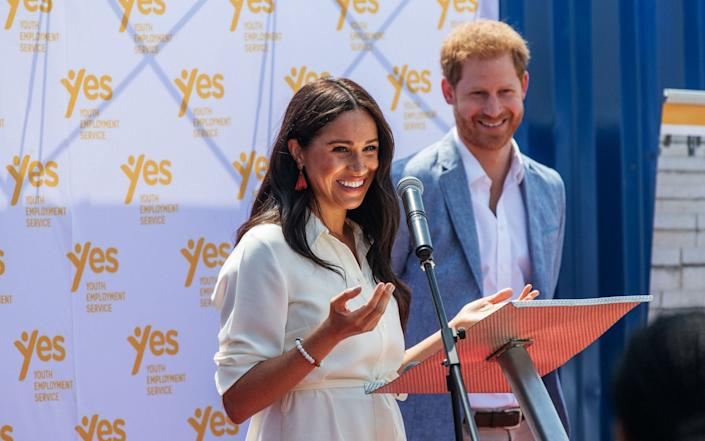 The Duchess of Sussex is watched by husband Duke of Sussex as she delivers a speech at the Youth Employment Services Hub in Tembisa township, Johannesburg. - AFP