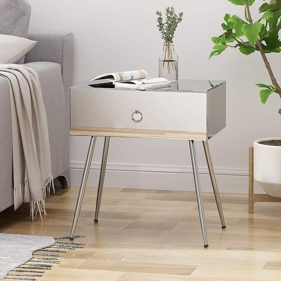 <p>In love with mirrored furniture? Get this <span>Georgia Modern Mirrored Accent Table</span> ($156) as a bedside table or for your living room.</p>