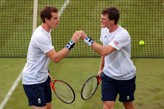 LONDON, ENGLAND - JULY 28: Andy Murray and Jamie Murray of Great Britain reacts after a point against Alexander Peya and Jurgen Melzer of Austria during their Men's Doubles Tennis match on Day 1 of the London 2012 Olympic Games at the All England Lawn Tennis and Croquet Club in Wimbledon on July 28, 2012 in London, England. (Photo by Clive Brunskill/Getty Images)