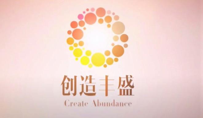 The wreathlike logo of the Chinese spiritual group Create Abundance, also known as Golden Touch. Photo: YouTube