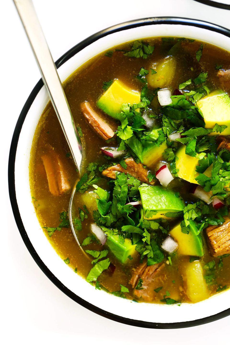 """<p>Soup is a great weight loss meal, and when you pair it with filling protein from steak, it'll be even more satiating until morning. This soup by<a href=""""https://www.gimmesomeoven.com/salsa-verde-steak-soup/"""" rel=""""nofollow noopener"""" target=""""_blank"""" data-ylk=""""slk:Gimme Some Oven"""" class=""""link rapid-noclick-resp""""> Gimme Some Oven</a> is packed with spicy flavors like poblano, garlic, and onion to fire the metabolism. (Though if you want it milder, add in extra stock or water to thin it out.)</p>"""