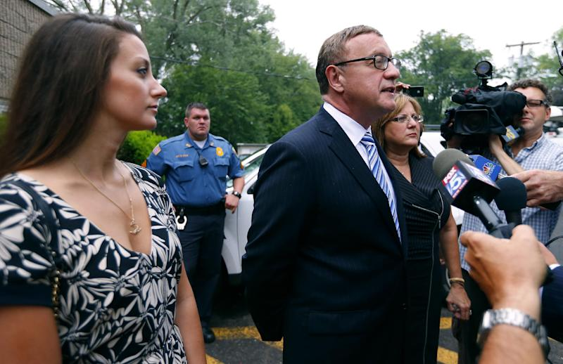 Republican U.S. Senate candidate Steve Lonegan talks to the media at the Bogota Recreation Center after he voted with his daughter Brooke, left, and wife, Lorraine, in the special election primary in Bogota, N.J., Tuesday, Aug. 13, 2013. (AP Photo/Rich Schultz)