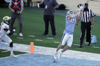 North Carolina tight end Garrett Walston (84) catches a touchdown pass during the second half of an NCAA college football game against Wake Forest in Chapel Hill, N.C., Saturday, Nov. 14, 2020. (AP Photo/Gerry Broome)