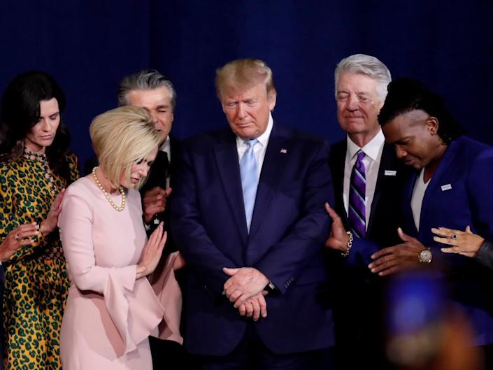 Trump appointed televangelist Paula White [2nd from left] as a faith adviser in the White House: AP