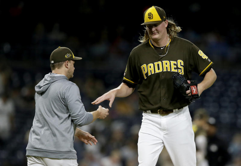 San Diego Padres relief pitcher Trey Wingenter, right, is removed by manager Andy Green during the eighth inning of the team's baseball game against the Arizona Diamondbacks in San Diego, Friday, Sept. 20, 2019. (AP Photo/Alex Gallardo)