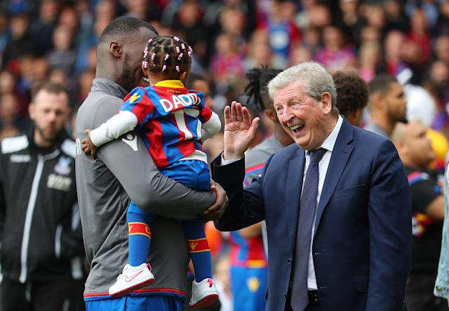 "Soccer Football - Premier League - Crystal Palace vs West Bromwich Albion - Selhurst Park, London, Britain - May 13, 2018 Crystal Palace's Christian Benteke and child with Crystal Palace manager Roy Hodgson after the match REUTERS/Hannah McKay EDITORIAL USE ONLY. No use with unauthorized audio, video, data, fixture lists, club/league logos or ""live"" services. Online in-match use limited to 75 images, no video emulation. No use in betting, games or single club/league/player publications. Please contact your account representative for further details."