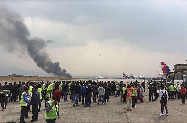 The wreckage scene of a crashed airplane is seen at the Tribhuvan International Airport. Authorities said the 78-seat airplane caught fire after crash-landing. Source: Getty