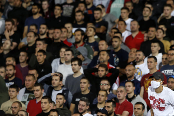 Red Star fans watch the Serbian National Cup semi final soccer match between Partizan and Red Star in Belgrade, Serbia, Wednesday, June 10, 2020. (AP Photo/Darko Vojinovic)