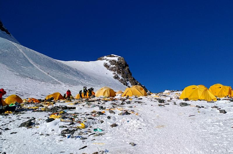 Discarded climbing equipment and rubbish scattered around Camp 4 of Mount Everest, where decades of commercial mountaineering have left a trail of discarded waste (AFP Photo/Doma SHERPA)