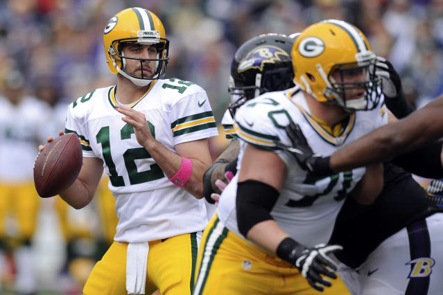 Green Bay Packers quarterback Aaron Rodgers looks for an opening to pass during the first half of a NFL football game against Green Bay Packers in Baltimore, Sunday, Oct. 13, 2013. (AP Photo/Nick Wass)