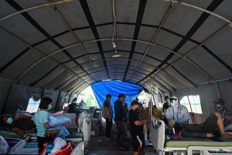 A makeshift ward was set up outside a regional hospital due to concerns of aftershocks in Mamuju