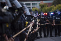In this Sept. 25, 2020 photo, a line of police officers block protesters in Louisville, Ky. Most police officers who violate citizens' rights get away with it because the law is heavily stacked in their favor, legal experts say. (Isabel Miller via AP)