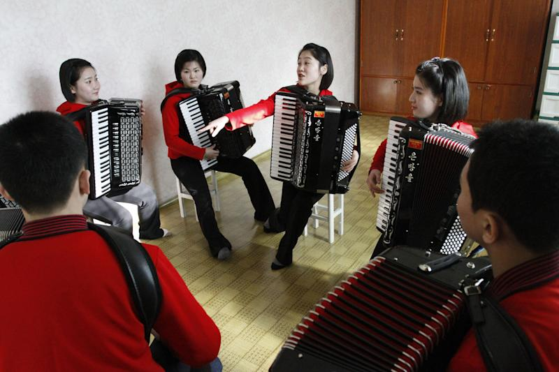 """In this Feb. 25, 2012 photo, students rehearse with accordions in a practice room at the Kumsong school in Pyongyang, North Korea. A group from the school became an Internet sensation with their accordion version of 1980's pop group A-ha's """"Take on Me."""" (AP Photo/Kim Kwang Hyon)"""