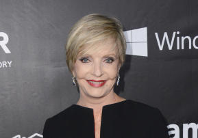 """FILE - In this Oct. 29, 2014 file photo, Florence Henderson arrives at the 2014 amfAR Inspiration Gala at Milk Studios in Los Angeles. Henderson, the wholesome actress who went from Broadway star to television icon when she became Carol Brady, the ever-cheerful mom residing over """"The Brady Bunch,"""" has died at age 82. She died surrounded by family and friends, her manager, Kayla Pressman, said in a statement late Thursday, Nov. 24, 2016. (Photo by Jordan Strauss/Invision/AP, File)"""