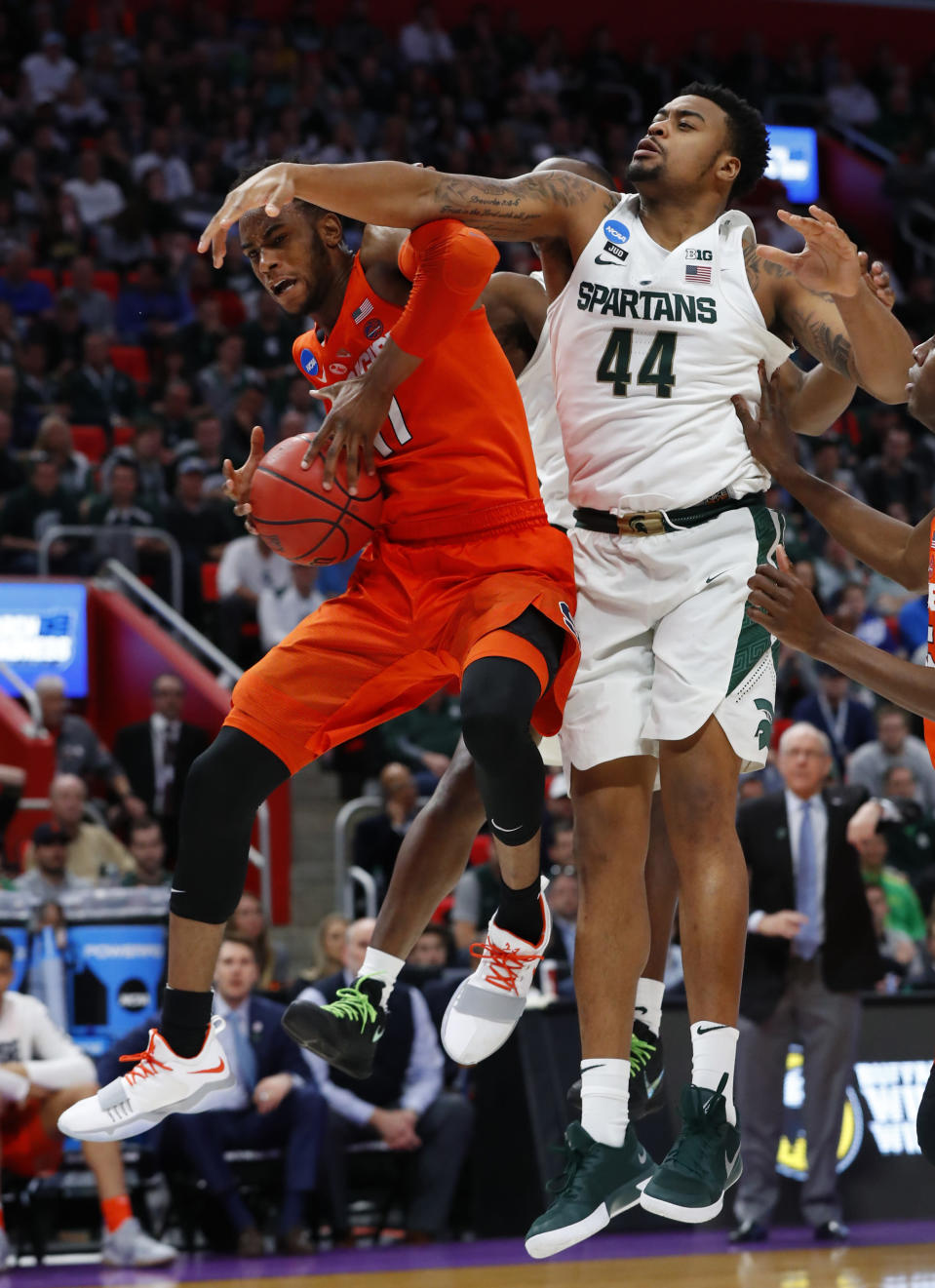 Syracuse forward Oshae Brissett (11) drives against Michigan State forward Nick Ward (44) during the second half of an NCAA men's college basketball tournament second-round game in Detroit, Sunday, March 18, 2018. (AP Photo/Paul Sancya)