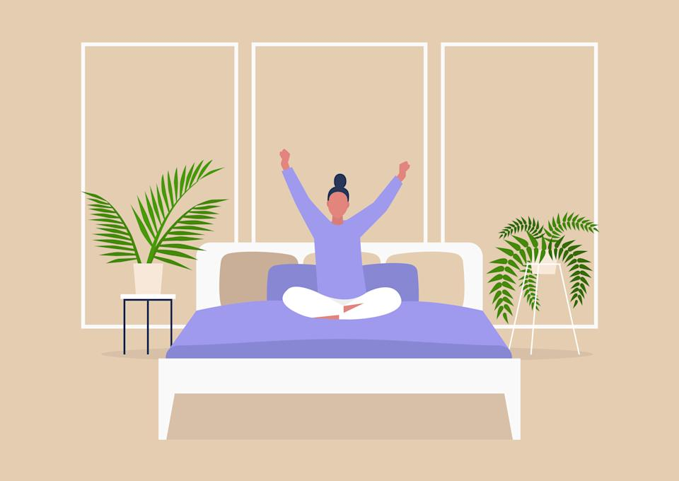 Doing gentle stretches in the morning can help undo the damage caused by sitting at a desk all day and weird sleeping positions at night. (Photo: nadia_bormotova via Getty Images)
