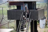 South Korean soldiers walk down from their guard post near the demilitarized zone separating the two Koreas in Paju