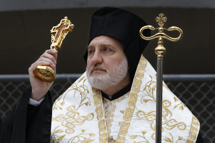 In this Dec. 6, 2019, photo, Greek Orthodox Archbishop Elpidophoros leads a celebration of St. Nicholas Day, at the St. Nicholas National Shrine at the World Trade Center in New York. Gov. Andrew Cuomo and officials with the Greek Orthodox church announced Thursday, Jan. 2, 2020, that they have a plan to complete construction of the church in time for the 20th anniversary of the 2001 terrorist attacks. (AP Photo/Mark Lennihan)