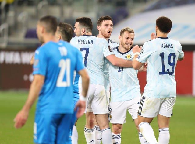 Ryan Fraser, second right, earned Scotland a point in Israel