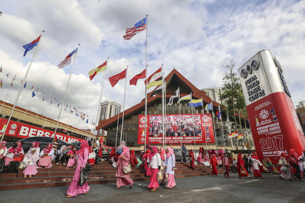 Delegates are pictured outside Putra World Trade Centre (PWTC) in Kuala Lumpur during Umno general assembly December 6, 2017. — Picture by Yusof Mat Isa