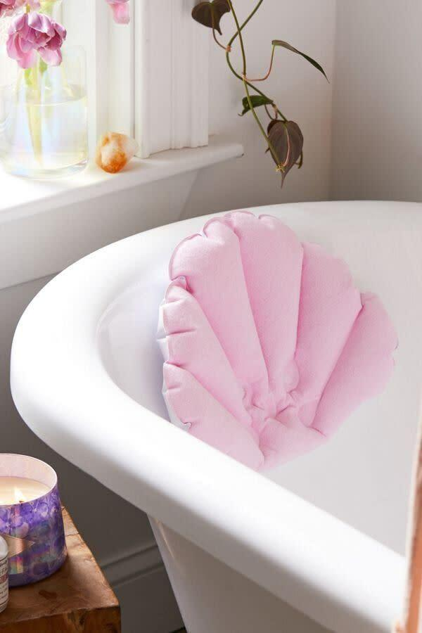 """For the friend who follows a night bath routine, this seashell neck pillow's perfect for them to get some much-needed rest and relaxation. It has a suction cup in the back to stick to a bathtub. <a href=""""https://fave.co/2qrkl8G"""" rel=""""nofollow noopener"""" target=""""_blank"""" data-ylk=""""slk:Get it for $16 at Urban Outfitters"""" class=""""link rapid-noclick-resp""""><strong>Get it for $16 at Urban Outfitters</strong></a>.&nbsp;"""