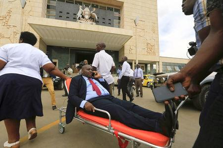A sick opposition Ugandan lawmaker is wheeled on a stretcher to attend the debate in parliament to change the constitution to extend the president's rule, in Kampala, Uganda September 21, 2017. REUTERS/James Akena