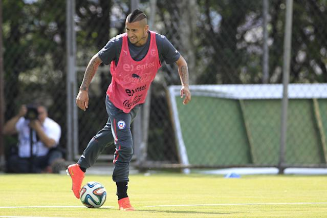 Chile's Arturo Vidal trains with his team for the World Cup in Belo Horizonte, Brazil, Wednesday, June 11, 2014. The international soccer tournament starts Thursday. (AP Photo/Bruno Magalhaes)