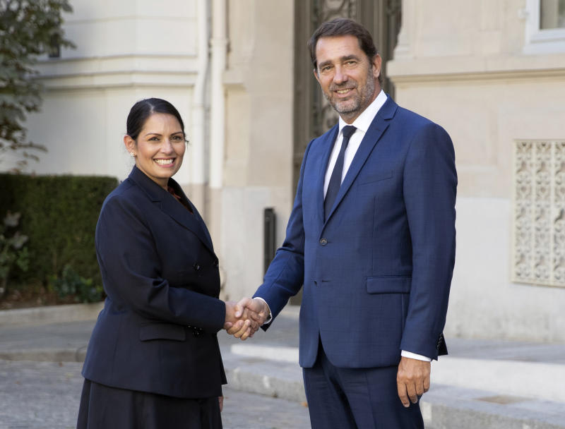 French Interior Minister Christophe Castaner , right, welcomes his British counterpart Priti Patel prior to a meeting at Interior Ministry in Paris, France, Thursday Aug. 29, 2019. (Zakaria Abdelkafi, Pool photo via AP)
