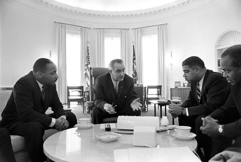 "In this image from the LBJ Presidential Library, from left Martin Luther King Jr., President Lyndon B. Johnson, Whitney Young, James Farmer attend a meeting on Civil Rights in the Oval Office of the White House on Jan. 18, 1964, in Washington. Rep. John Lewis, D-Ga., tells the story of Young's boldness in dealing with civil rights issues in ""The Powerbroker: Whitney Young's Fight For Civil Rights"" a documentary airing during Black History Month on PBS' Independent Lens and shown in some community theaters. (AP Photo/LBJ Presidential Library, Yoichi Okamoto)"
