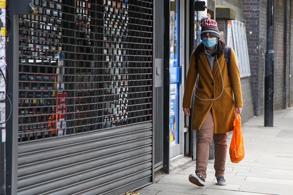 A man wearing a face mask as a precaution against the spread of covid-19 walks past a shop in London during the lockdown. Prime Minister Boris Johnson has announced a roadmap to ease the lockdown restriction with primary and secondary school students to return back to schools on 8th March. (Photo by Dinendra Haria / SOPA Images/Sipa USA)
