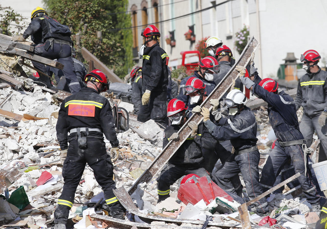 "French firemen search in the rubble of a building after an explosion collapsed it, in Rosny-sous-Bois, outside Paris, Sunday, Aug. 31, 2014. French authorities say a four-story building in a northeastern Paris suburb has collapsed after an explosion, killing a child. More people are thought to underneath the rubble. Speaking on i-Tele, fire department spokesman Gabriel Plus said around 10 people were evacuated from the building in Rosny-sous-bois that occurred early Sunday morning. Plus said that around another 10 people could still be underneath the rubble, and emergency teams were working hard to rescue people who might be trapped. ""We could still find living victims in the hours to come,"" he said. Interior Minister Bernard Cazeneuve has arrived at the scene, but couldn't confirm a theory that the explosion was caused by a gas leak. (AP Photo/Christophe Ena)"