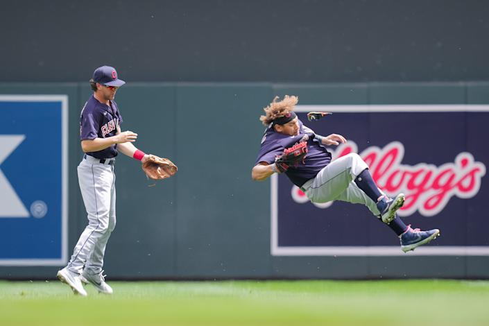 Jun 27, 2021; Minneapolis, Minnesota, USA; Cleveland Indians second baseman Ernie Clement (28) and outfielder Josh Naylor (22) collide on a fly ball against the Minnesota Twins in the fourth inning at Target Field. Mandatory Credit: Brad Rempel-USA TODAY Sports