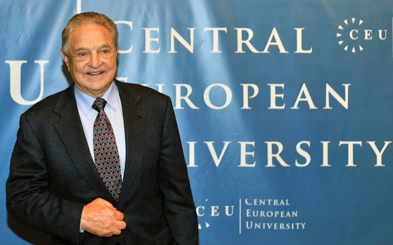 George Soros, pictured in 2009, at the Central European University, CEU, in Budapest, Hungary before delivering a five-day lecture series. - Credit: AP