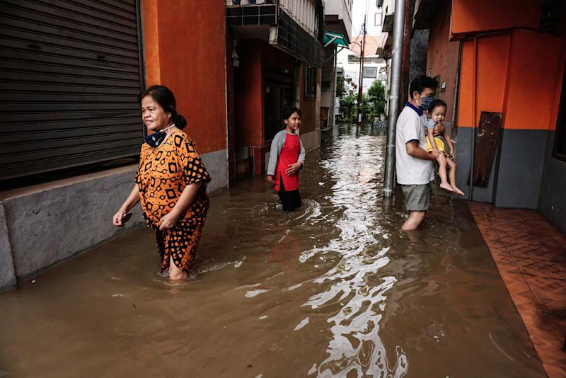 JAKARTA, Oct. 5, 2020 -- People walk through floodwater after a heavy rain at a residential area in Jakarta, Indonesia. Oct. 5, 2020. (Photo by Arya Manggala/Xinhua via Getty) (Xinhua/Arya Manggala via Getty Images)