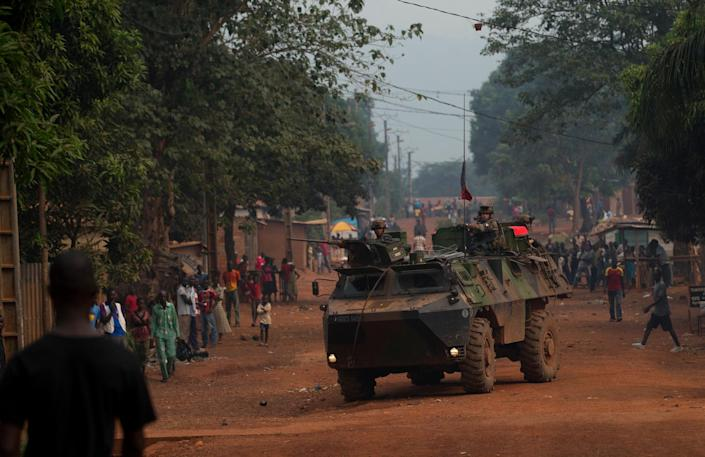 French soldiers drive through the Miskine neighborhood of Bangui, Central African Republic, Thursday, Dec. 26, 2013. The spokesman for an African Union peacekeeping force says six Chadian peacekeepers were killed and 15 were wounded, after being attacked Wednesday.(AP Photo/Rebecca Blackwell)