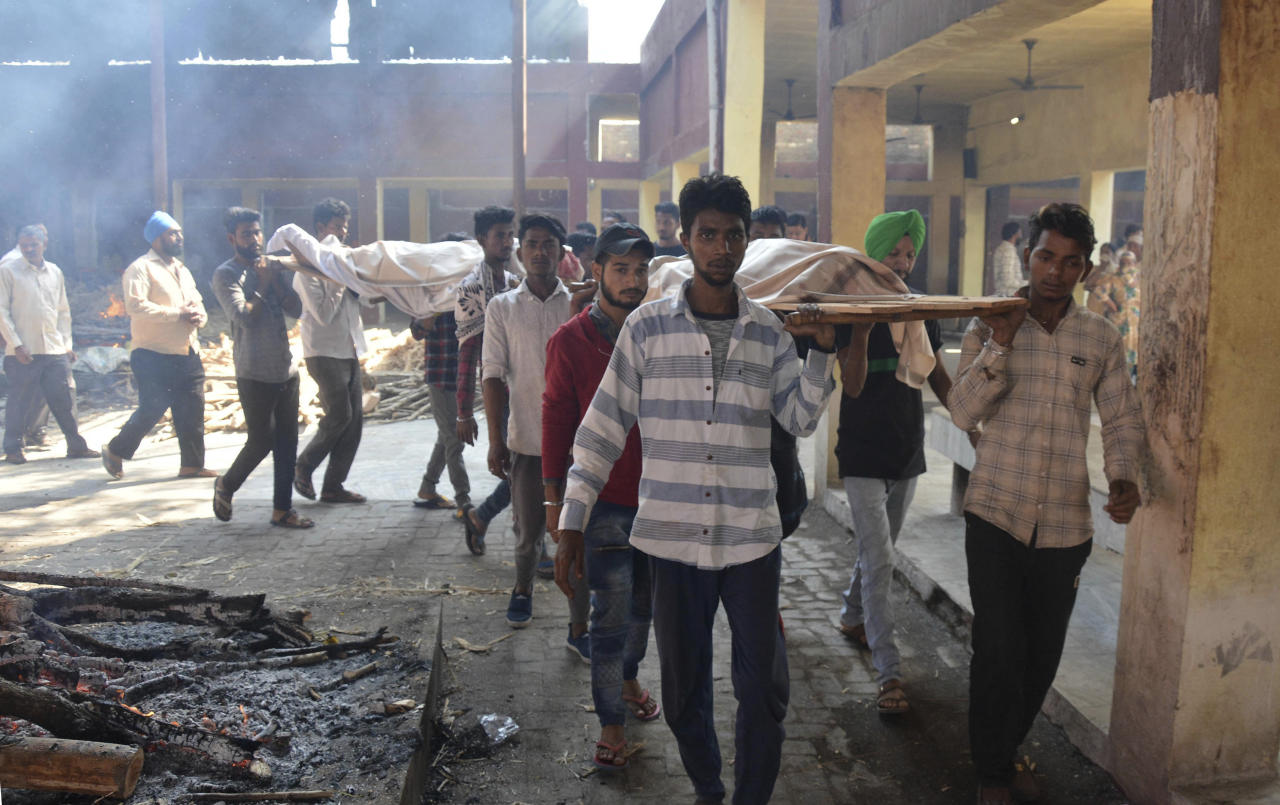 <p>Bodies of victims of Friday's train accident are carried in for cremation in Amritsar, India, Saturday, Oct. 20, 2018. (Photo: Prabhjot Gill/AP) </p>